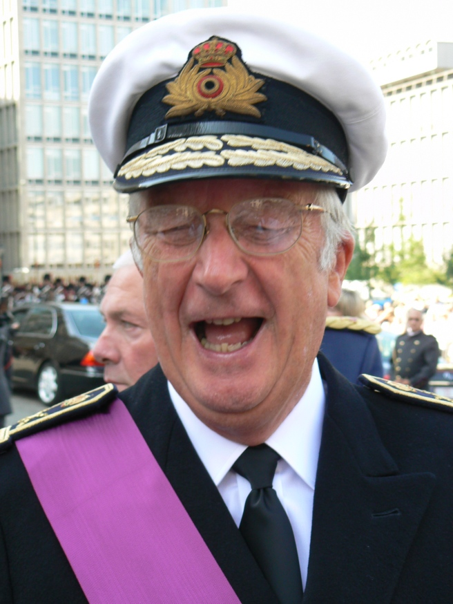 King Albert II of Belgium laughs at his own stupid joke.