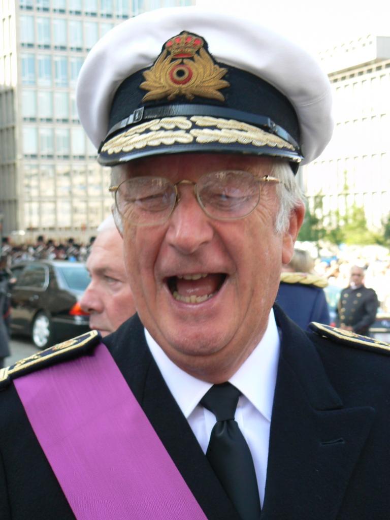 King Albert II of Belgium laughs at his own stupid joke.